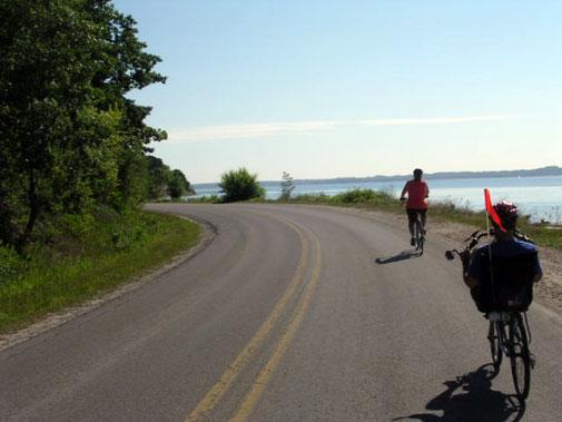 Brad follows Mrs. Noob around a curve on Bluff Road.