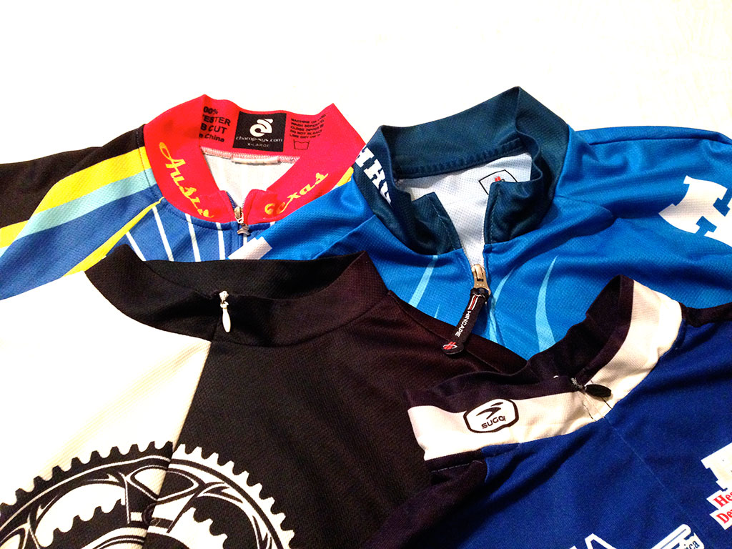 A sample of my jerseys. Clockwise from top left: Champion Systems, Hincapie, Sugoi, Primal. I can pull the Hincapie zipper with one hand, because of the long pull tab.
